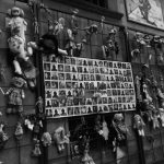 """""""Wall of Dolls"""" is a artistic manifestation that denunciates and exposes de femicide in Italy. The dolls tied in the bars around the poster, which have photos of real victims, allude to the childhood innocence and the violence experienced by women and girls. When my eyes caught sight of this instalation, I, only 14 years old, got scared. In that moment, my bewilderment turned to pain and, I remenber like it was yesterday, how touched I felt by what I was watching. I realized everything. Being born a woman is a resistance, a fight. Photography made in Rome, 2018."""